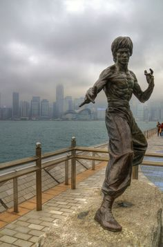 Statue of Bruce Lee located on the Avenue of Stars, along the Victoria Harbor waterfront, Tsimshatsui, Kowloon, Hong Kong