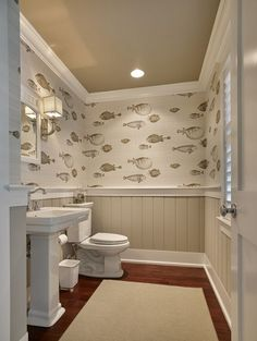 bathroom at the beach house. Wallpaper is Cole and Acquario Fornasetti II. I think I'd like this in the kids bathroom. bathroom at the beach house. Wallpaper is Cole and Acquario Fornasetti II. I think I'd like this in the kids bathroom. Wainscoting Stairs, Dining Room Wainscoting, Wainscoting Bathroom, Wainscoting Ideas, Painted Wainscoting, Beadboard Wainscoting, Coastal Bathrooms, Beach Bathrooms, Fish Bathroom