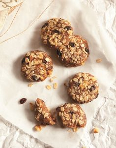 2 cups (200 g) walnuts  1 cup (30 g) (178 g) packed Medjool dates, pitted (soak for 15 minutes if they are very dry)  1 cup (80 g) rolled oats  ½ tablespoon (7.5 ml) vanilla extract  1 teaspoon cinnamon  1⁄₄ teaspoon sea salt  ½ cup (73 g) raisins  Additional  2⁄₃ cup (80 g) chopped walnuts  1⁄₄ cup (20 g) rolled oats