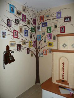 Photo wall. Tree...white tree, gray wall, yellow frames! in family room/master