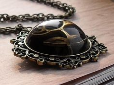 Antique Flower Brass Resin necklace by Janimie on Etsy, $22.95  @janimie #janimiegiveaway