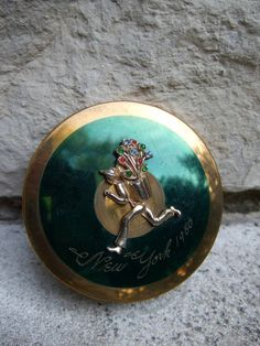 Vintage figural rhinestone compact. c 1960  Elegant figural compact with a man carrying  a bouquet of flowers. The compact lid is  engraved