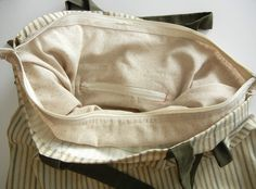 How to add zippers to linings in bags.  This website has useful tutorials.