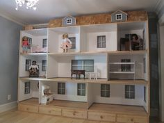 American Girl Doll house is 10' long and 8' high with 9 rooms, a deck, dormers and shingles!! We build these by the square foot and ship anywhere