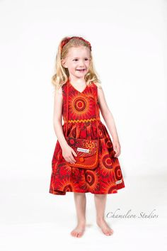 Cotton ShweShwe Made in South Africa African children's clothes by Jenni Dezigns. The sleeveless crossover bodice, with full back straps, is brought to life with bead work on the front sunpoin… African Print Clothing, African Print Dresses, Girls Party Dress, Girls Dresses, Summer Dresses, Shweshwe Dresses, African Children, Fashion Prints, South Africa