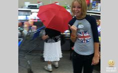 Lol why does she have an umbrella INSIDE the store? Lol