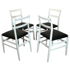 Set of Four Gio Ponti Leggera Chairs by Cassina | From a unique collection of antique and modern dining room chairs at…