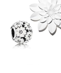 PANDORA Primrose Meadow charm. Each of the 12 graceful flowers is embellished with hand-applied enamel and a clear cubic zirconia that makes it sparkle. #PANDORAcharm
