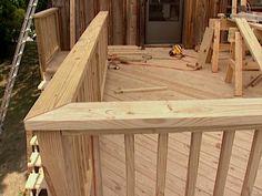 rail cap adds finishing touch to deck Wood Deck Railing, Deck Railing Design, Wood Handrail, Deck Design, Railing Ideas, Deck Maintenance, Outdoor Deck Decorating, Cabin Decks, Balustrades