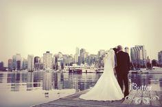 romantic shot with the vancouver skyline from the deck of the vancouver rowing club - photo courtesy of butter media Vancouver Skyline, Rowing Club, Stanley Park, Wedding Photos, Wedding Ideas, New York Skyline, Wedding Planning, Deck, Romantic