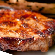 Country Style Baked Pork Chops Recipe Main Dishes with bone-in pork chops, ketchup, brown sugar, salt, pepper, onion slices, cold water