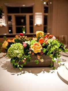 Wine box centerpiece... could add a couple bottles in between flowers...