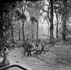 SE 21 1944 Arnhem: British paratroopers continue to hold out: A wounded man being carried away from the Divisional Administration Area by stretcher (note the stocks of ammunition and fuel dumped in the background) at Oosterbeek. National Geographic, Airborne Army, Operation Market Garden, Parachute Regiment, War Photography, Paratrooper, Garden Pictures, World War Two, Netherlands