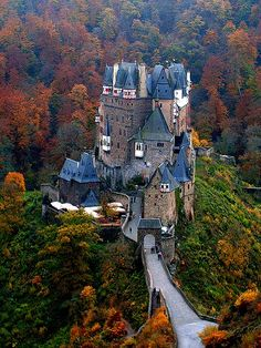Burg Eltz Castle by Alex Shar. Burg Eltz is a medieval castle nestled in the hills above the Moselle River between Koblenz and Trier, Germany. It is still owned by a branch of the same family that lived there in the century, 33 generations ago Places To Travel, Places To See, The Places Youll Go, Travel Destinations, Beautiful Castles, Beautiful Buildings, Eifel Germany, Bavaria Germany, Burg Eltz Castle