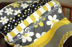 Yellow and gray baby quilt made with retro fabrics.  Such a simple pattern.