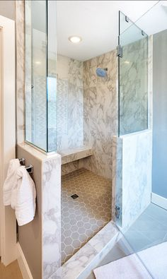 Shower configuration with pony wall. Like the addition of the towel bar on the wall going into the shower.