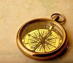 11141123-Antique-golden-compass-on-old-paper-studio-shot--Stock-Photo.jpg (1300×1121)