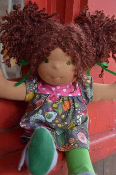 This is Catherine, a Bamboletta Cuddle Doll from the July 25, 2014 upload.  She has dark tan skin, long hair made with mohair boucle in an auburn brown color and green eyes.  She is wearing the pictured outfit, underpants and felt wool shoes.