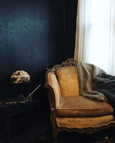 old gold chair & a dark wall