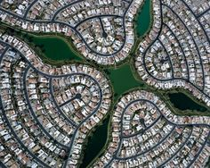 "Photographer Christopher Gielen looks at his large-scale aerial shots of urban planning, titled ""Ciphers,"" as a code of human habitation that needs deciphering, like this picture of a neighborhood in Arizona."