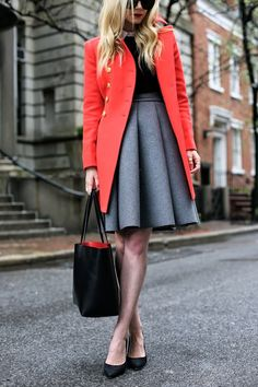 Red military coat, grey skirt and black top