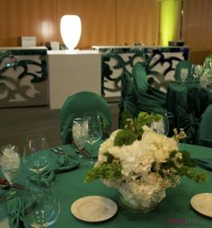 Green tablescape with spring flowers and mirrored bar ~ #party #bar #eventdecor #eventuresinc