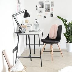 Pretty black and white work space with pink accents. Budget friendly and functional!