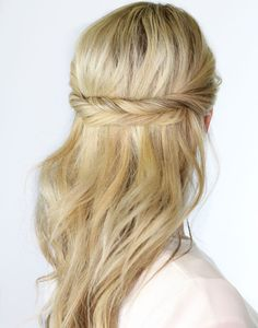 If you'd like to go simple, consider this gorgeous look with extra loose waves and twisted pieces that keep your hair out of the way. See more of this Twisted Hairhere.