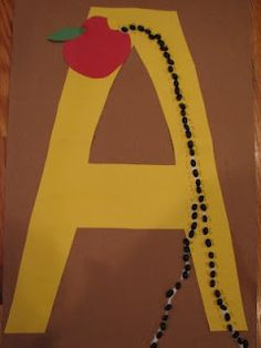 """A"" is for Ants and Apples. For this project we used construction paper, scissors, glue and dry black beans."