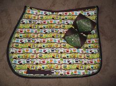 The OWLS!  Custom made English Saddle Pad with Green Bling and matching Chocolate polos $65.  Available on Etsy and Ebay at thebarncloset.