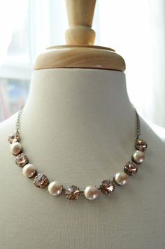 This necklace was made with 12mm Vintage Rose Swarovski Crystals and Swarovski Pearls and set in an antique silver chain. This piece is very versatile! Wear it with a fun flirty dress, blue jeans and white T-shirt or use it as bridesmaid Jewelry!
