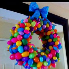 Easter Egg Wreath... Incredibly easy! Made with pool noodle, duct tape, & hot glue gun.