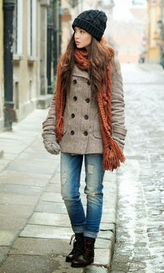 Perfect winter outfits woolen hat, knitted scarf and warm pea-coat