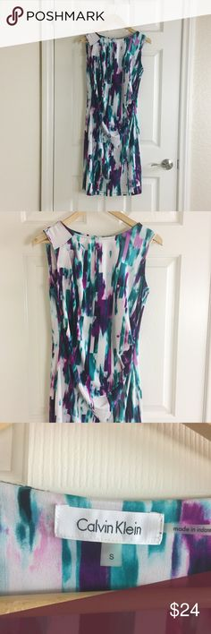 Calvin Klein Dress Calvin Klein dress with purple and teal abstract watercolor pattern. Pin tuck detail at one shoulder, draping across front to ruche detail at waist. Calvin Klein Dresses