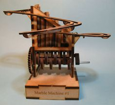wooden automata hand crank   ... commercially available laser-cut minature hand-cranked marble machine