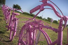 pink bicycle fence  Oh, my goodness this just makes me smile so much.
