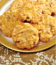 Martha Nesbit's Crispy Cheese Wafers  Makes about 4 dozen  1 cup (2 sticks) butter, softened  2 cups grated sharp Cheddar cheese  2 cups all-purpose flour  1/4 teaspoon salt  1/4 teaspoon cayenne pepper  2 cups Rice Krispies or other puffed rice cereal  1/2 cup finely chopped pecans    1. Preheat oven to 350 degrees F. Combine butter and cheese in mixer. Sift together flour...