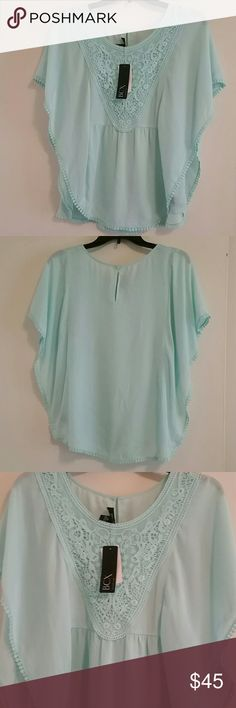 *WEEKEND SALE* *NWT SALE* BCX Poncho Top *NWT* BCX Poncho Top, size Medium. Mint color. BCX Tops