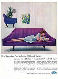 An incredible mid century designed sofa in purple DuPont fabric...