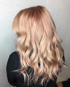 Aveda Artist Lauren gave this bright blonde a hint of rose gold for a subtle, pretty spring hair color look.