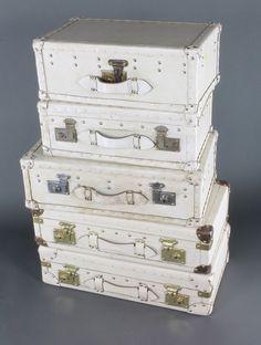 "Lot 159, Five white stage prop sealed suitcases, 2 - 7"" x 14"" x 26"", 1 - 8"" x 24"" x 8"", 2 - 8"" x 21"" x 8"", Est £50-100"