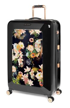 Opulent blooms put a contemporary spin on this hard-shell suitcase with rose gold hardware.