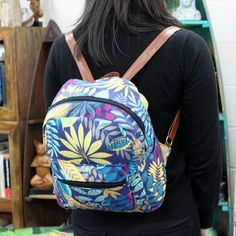 Jungle Bag - Undersized Backpack - Blue / Teal | Hip  Angels Beautiful Jungle Backpack with two external pockets for those small items and two internal pockets where one comes with a zipper. This backpack is very comfy and its good enough to carry all the school supplies.  #Scarves_wholesale #Bags_wholesale #Jungle_bags #Flowersbags #Backpackwholesale #Big_backpack