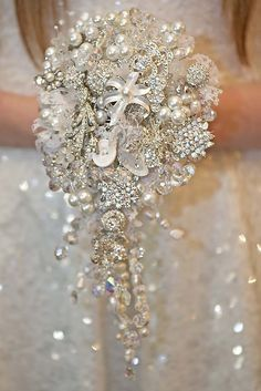 Chic Brooch Wedding Bouquets With Bling ❤ See more: http://www.weddingforward.com/brooch-wedding-bouquets/ #weddings