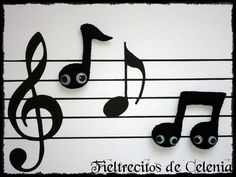 Music... love the little eyes added o the notes!