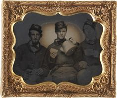 ca. 1860's, [Tintype portrait of three federal soldiers enjoying hardtack and coffee]    via Heritage Auctions