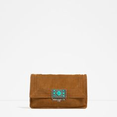 LEATHER CROSS BODY BAG WITH STONE DETAIL CLOSURE