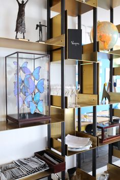 The bar at the Vesper Hotel Noordwijk | Design Hunter . The brass plates are a nice touch and idea for display