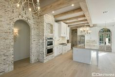 Delta's kitchen showcases exposed brick, tall archways, and gorgeous light fixtures that give the impression of an Italian Villa. Dream Home Design, My Dream Home, Dream Homes, House Goals, Home Interior, Dream House Interior, Future House, Home Kitchens, Farmhouse Kitchens