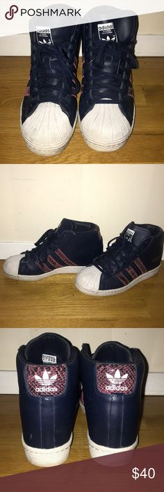 Adidas high top wedged sneakers Navy blue adidas high top sneakers. These sneakers have a wedge in them to give you a little height. Burgundy stripes and accents. White toes. Shoes are a size 8.5, but they run big and fit a size 9. adidas Shoes Sneakers